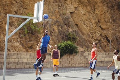 Basketball players playing basketball in the court
