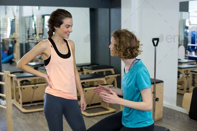 Female trainer interacting with woman