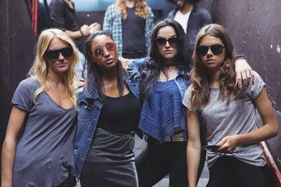 Portrait of female friends wearing sunglasses while staning together
