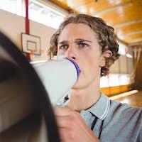 Male coach using megaphone