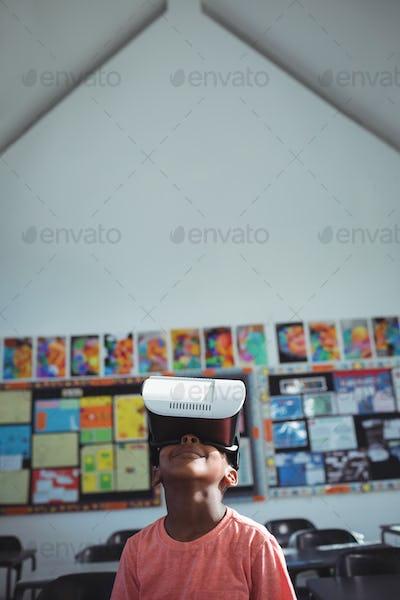 Boy with virtual reality simulator in school