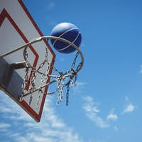 Low angle view of blue basketball in hoop