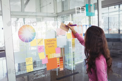 Designer making strategy on glass in creative office