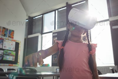 Girl wearing virtual reality simulator