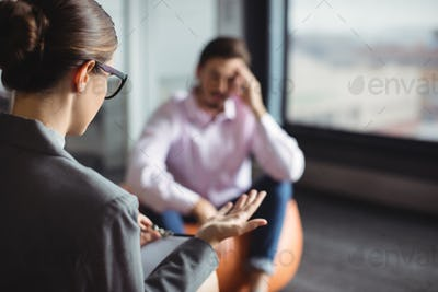 Counselor interacting with unhappy man