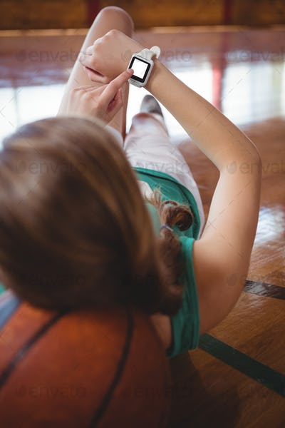 Female basketball player using smart watch