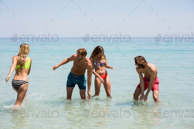Cheerful young couples enjoying in sea
