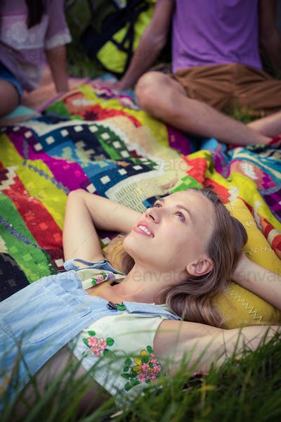 Woman relaxing at campsite