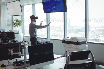 Side view of businessman using virtual reality technology
