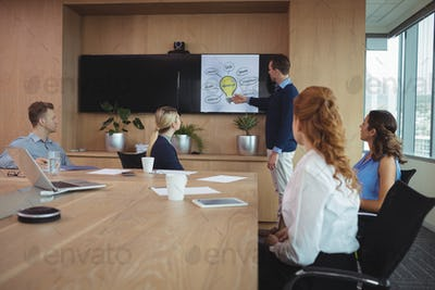 Businessman explaining plans to team