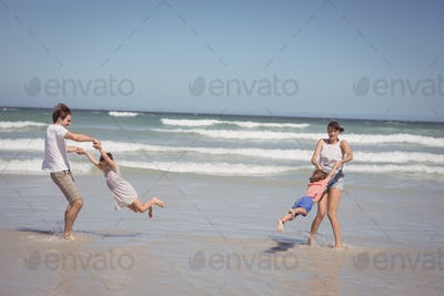 Happy family enjoying on shore at beach