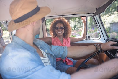 Couple interacting with each other in campervan