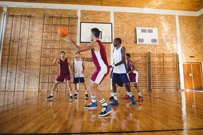 Basketball players playing in the court