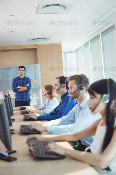 Supervisor with business team working at call center
