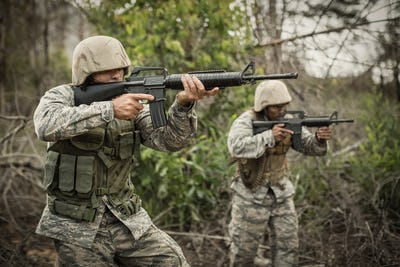 Military soldiers during training exercise with weapon