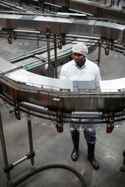 Factory engineer monitoring a production line