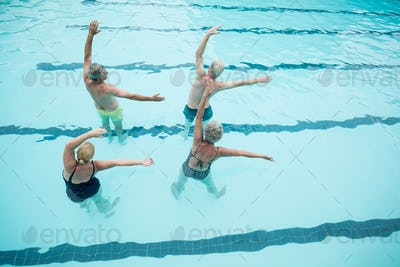Senior swimmers exercising in swimming pool