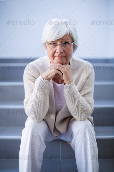 Portrait of senior woman sitting on stairs
