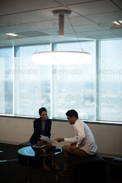 Business colleagues discussing over document