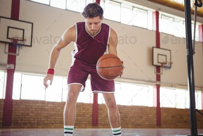 Male player practicing basketball
