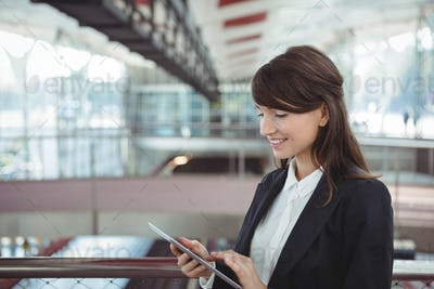 Businesswoman using digital tablet on platform
