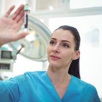 Nurse looking at the blood sample