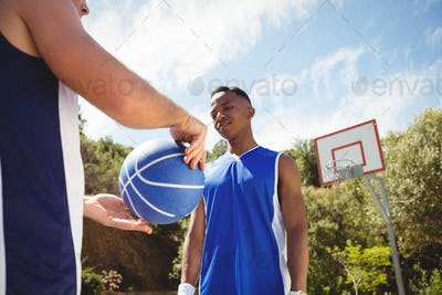 Man showing basketball to friend