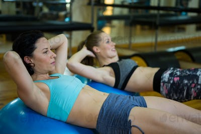 Fit women exercising on fitness ball