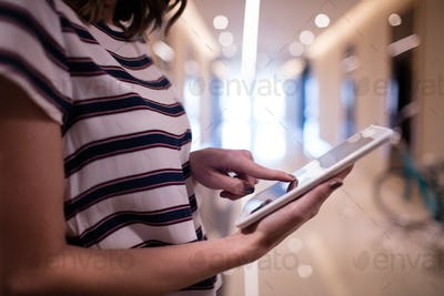 Side view of businesswoman using digital tablet
