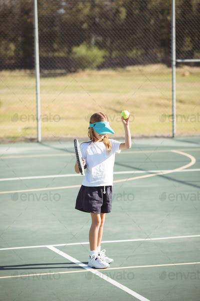 Girl playing tennis at court