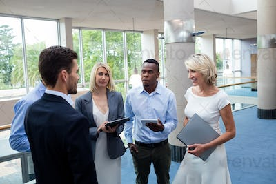 Business executives interacting in a conference center lobby