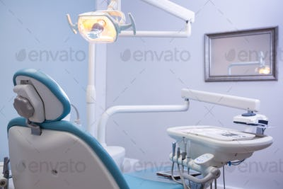 Chair and medical equipments at dental clinic