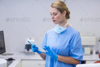 Female nurse using digital tablet