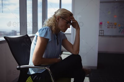 Sad executive sitting on chair