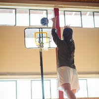 Female basketball player practicing in court