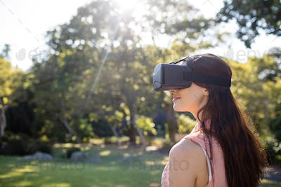 Woman using a VR headset in the park