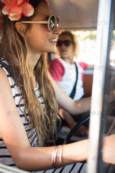 Side view of woman driving camper van