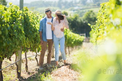 Young couple standing at vineyard