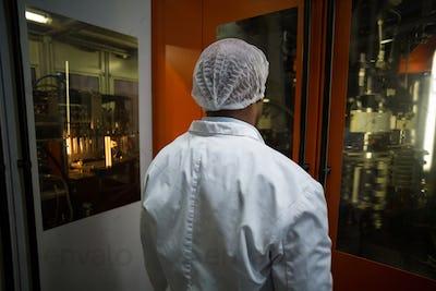Factory engineer looking at machine