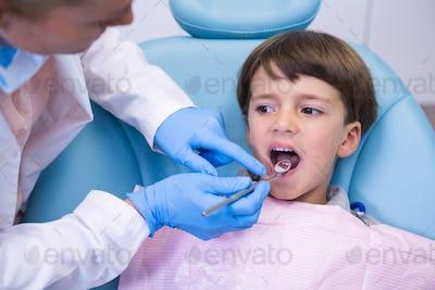 Dentist examining boy at clinic