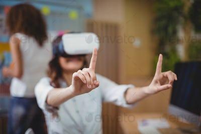 Female business executive using virtual reality headset