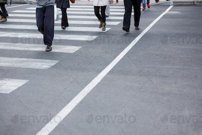 Pedestrians crossing the road