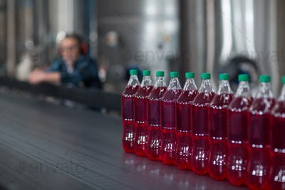 Bottles of juice on conveyer belt