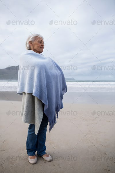 Senior woman standing on the beach
