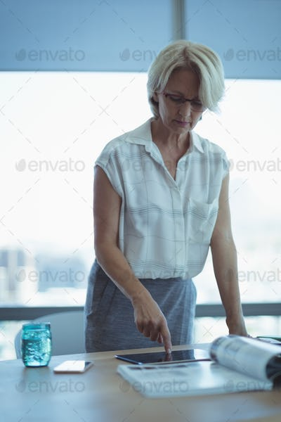 Businesswoman working at table