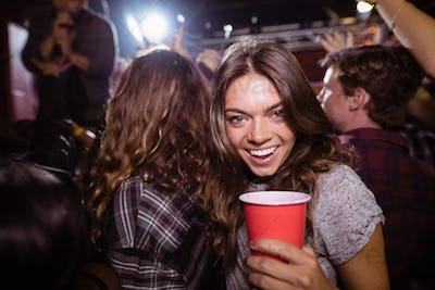 Portrait of happy woman enjoying music festival