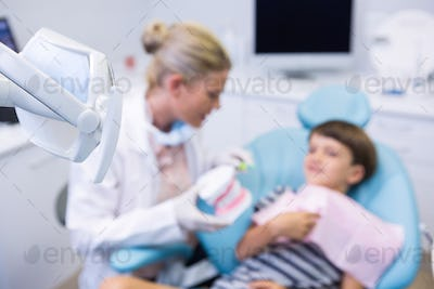 Boy receiving treatment by dentist