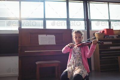 Schoolgirl rehearsing violin