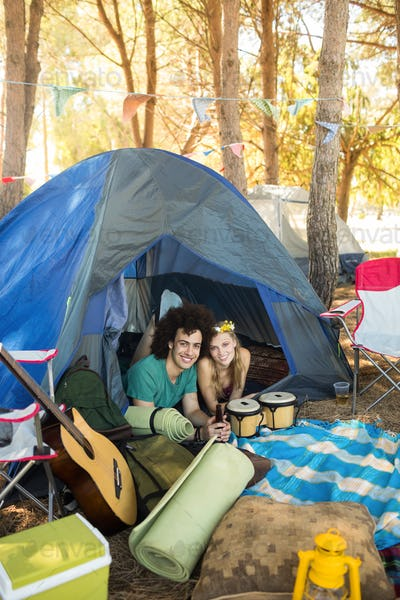 Portrait of smiling couple in tent