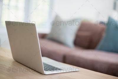 Close-up of laptop on table in living room